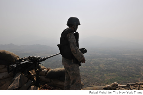 A Saudi border guard looks towards Yemen from his post near Jizan, Saudi Arabia. The remote 1,100-mile frontier of the Saudi-Yemebi border has become an emblem of the increasingly global threats emanating from Yemen: fighters from al-Qaida, Shiite insurgents, drugs and arms smuggling and one of the largest flows of economic refugees on earth. (Faisal Mehdi/The New York Times)